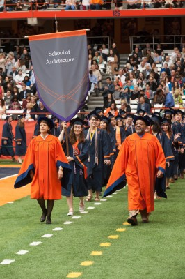 Class marshal Angela Copes '17 carries the banner and leads School of Architecture procession at SU Commencement 2017 ceremony